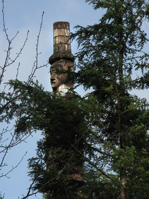 watchman figure seen through a tree, Kasaan, Alaska