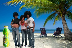 Relaxing on remote beach (yop_mx) Tags: travel blue sea summer sky people sun holiday beach water comfortable island sand chair women coconut turquoise unity palmtree meditating palapa remote watersedge females relaxation vacations twopeople enjoyment foldingchair 30s oneperson loungechair tranquilscene caribbeansea zenlike traveldestinations gettingawayfromitall tropicalclimate coconutpalmtree serenepeople outdoorchair