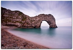 Jurassic arch at dusk (Terry Yarrow) Tags: uk sea england sky motion blur beach clouds canon evening coast movement surf tide dorset afterdark nightfall durdledoor jurassiccoast eos5d dorsetcoastpath