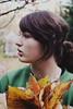 (christina.bendinger) Tags: autumn trees selfportrait fall nature girl leaves hair neck outside daylight backyard bokeh branches daytime ponytail sideview yellowleaves profileview greensweater lookingright turnedhead christinabendinger hodingleaves hanessweater