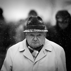 In the cold I'm standing (c.lemon) Tags: street bw snow man france cold hat square lyon bokeh candid streetphotography freezing snowing cinematic d90 nikond90 sauvette