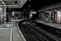 Waterloo Station - 23:42pm (Tom Cooke) Tags: new uk england london public station night train 50mm aperture time vibrant empty south year transport chinese tracks gritty east busy waterloo hour commute commuter 18 pm desolate eastern eleven waterloostation hectic bustling 2300