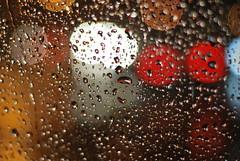 56/365 - windscreen bokah (Chicka (X100s enthusiast)) Tags: uk light england color colour london window wet rain night dark lights drops nikon streams nikkor d60 bokah
