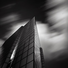 Metropolis (Joel Tjintjelaar) Tags: amsterdam architecture bwphotography concretejungle ultrawideangle nd110 bwnd110 bwfineart silverefexpro tjintjelaar daytimelongexposures theartofdaytimelongexposurephotography