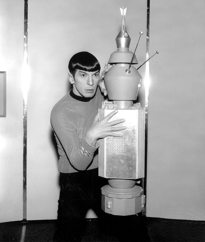 Leonard Nimoy cops a feel from an unsuspecting N.O.M.A.D. during an NBC press junket.
