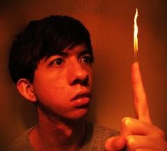 Day 119 (1-20-10) (Logomogohogo) Tags: selfportrait reflection eyes finger january flame 365days bobbywhatley
