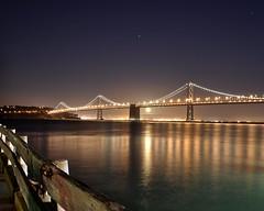 Bay Bridge Moonrise (c.nix) Tags: sanfrancisco california city sky moon water skyline night reflections landscape bay nikon cityscape treasureisland moonrise baybridge embarcadero sanfranciscobay nightsky tamron d90 tamronspaf1750mmf28xr