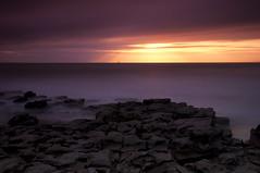 Sunset at Temple Bay (Edward Bentley) Tags: uk longexposure greatbritain sunset sea water southwales wales coast march rocks unitedkingdom britain glamorgan valeofglamorgan 2010 cokin templebay glamorganheritagecoast bw110 18105mm gradnd8 nikond90