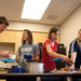 Students enjoy a meal together of local food.