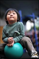 """Wanna play?"" (Ericinumass) Tags: green playground kids ball 50mm nikon dof jessica bokeh af nikkor f14d wannaplay d700"