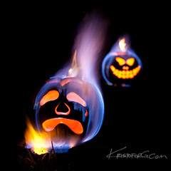 Evil Twin ( KristoforG) Tags: blue light orange yellow pumpkin hawaii candle flame gourd fir match stick lantern pyro liquid 2009 gellert flamable kristofor jockolantern