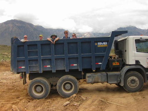 hitching a ride in a dumptruck