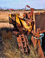 traxtor spicey (Paul Adames Noble) Tags: uk red sea tractor colour abandoned beach metal rust vibrant tracks machine olympus erosion windswept southofengland dungeness remote cog eastsussex tool vibrance weatherd e520 uksuncolour
