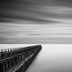 Human Nature I - Trespassing (Joel Tjintjelaar) Tags: sky seascape holland pier fishermen bwnd110 tjintjelaar 10stopsfilter dutchseascapes daytimelongexposures frozenmen