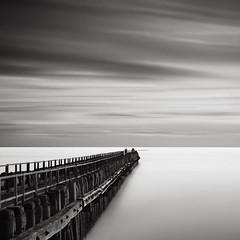 Human Nature I - Trespassing (Joel Tjintjelaar) Tags: sky seascape holland pier fishermen bwnd110 tjintjelaar 10stopsfilter dutchseascapes daytimelongexposures frozenmen