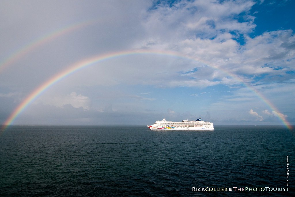 A double rainbow highlights the cruise ship Norwegian Jewel after a rain squall passes, in the anchorage at Belize.