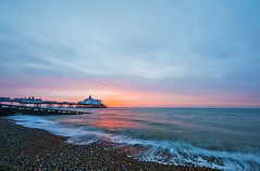 eastbourne sunrise (simon.anderson) Tags: ocean morning sea sky sun beach sunrise sussex pier morninglight early waves pebbles eastbourne coastline seafront polarizer southcoast goldenhour earlyriser eastbournepier sigma1020 simonanderson sussexcoast coastuk nikond300s