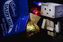 Photo 92/365 - Sprung! (Aerokev) Tags: japan easter lights robot amazon bokeh chocolate australia victoria cadbury spotlight figure carton 365 caught sprung dairymilk eastereggs milkchocolate danbo project365 eos450d revoltech danboard