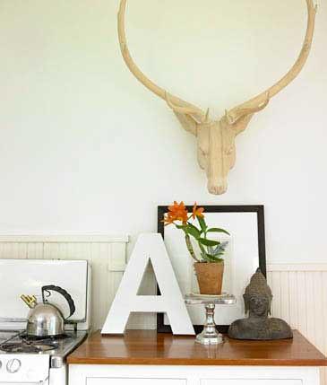 White kitchen: Artful display + faux deer head + Benjamin Moore 'Snow White'