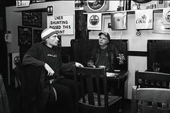 the distraction (teh hack) Tags: bw film pub flickr edmonton flash 14 el nb hp5 35 holmes minox bounce meets sherlock ddx