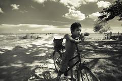 kompong phhluk.10 (nilai asia) Tags: boy bike bicycle children blackwhite cambodia village siemreap childrenportrait kompongphhluk