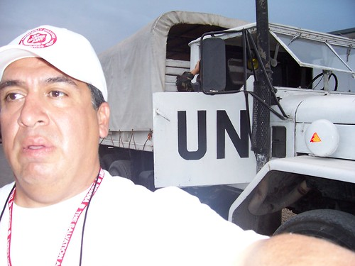Captain Marcos Ramirez with the UN troops who will help The Salvation Army's food distributiion.