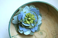 felt flower brooch in greens and blues
