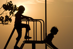 Silhouette of children on a slide on Colva Beach 1 (Pondspider) Tags: sunset sea india playing beach silhouette children goa colva colvabeach anneroberts salcette annecattrell pondspider