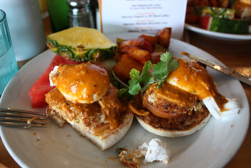 Crab eggs benedict with smoked tomato hollandaise.