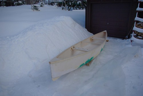 Snow everwhere but the resin and plywood have bonded to make the canoe.