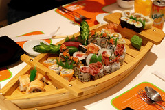 Sushi Boat (Rami ) Tags: food fish seaweed japan sushi cuisine japanese avocado raw rice maki salmon shrimp saudi arabia roll spicy sliced tuna riyadh yoshi nori ksa