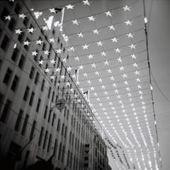 Stars (Kerrie McSnap) Tags: christmas city sky blackandwhite bw building 120 film mediumformat square stars holga lomo lomography toycamera melbourne christmasdecorations ilfordxp2 myers myerbuilding