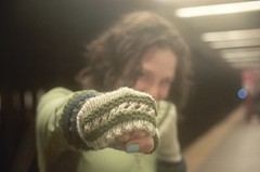 PUNCH (Knit n Frog) Tags: nyc blue green brooklyn subway coneyisland knitting lace knit handknit shorthair punch brunette curlyhair seafoamgreen darkblue armwarmers mitts handwarmers darkgreen handknitting subwayplatform fingerlessgloves picotedge shortcurlyhair susiesreadingmitts modadeabamboowool