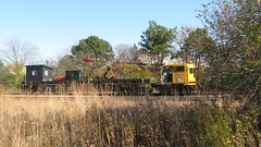 Metra m.o.w Burro crane and boom tender car. Glenview Illinois. Early November 2009.
