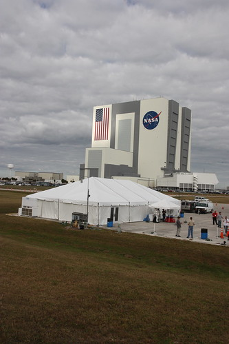 American Flag on VAB lit by spot of sunlight