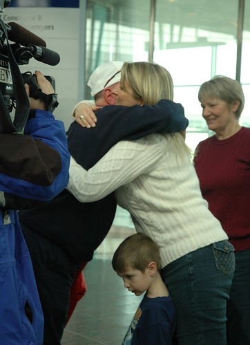 EDS Director Jerry Larsen is gets a hug from his daughter upon arriving at Indpls. International Airport on Sunday, February 14, 2010.