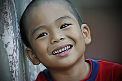 Birthday Boy (Gilbert Rondilla) Tags: birthday camera boy people color male slr love smile up horizontal closeup digital children asian happy photography photo child close bokeh philippines innocent gilbert filipino dslr nigel notmycamera own pinoy borrowedcamera rondilla notmyowncamera gilbertrondilla gilbertrondillaphotography luisianian gettyimagescollection familygetty2010 gettyimagesphilippinesq1 sibsphoenix
