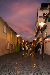 Sunset in the Streets of Fort de France, Martinique Carnival (Marie-Marthe Gagnon) Tags: street light sunset sky france socks marie buildings fort stones martinique marthe 10f sidewalk streetphoto 100 fortdefrance gagnon mariegagnon mariemarthegagnon mariemgagnon