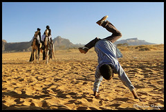 LOOK AT ME ! (Bashar Shglila) Tags: mountains sahara photography sand desert photos top skills camel gymnastics libya touareg tuareg libyan