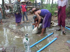 laying pipe for water spout (GHNI Pics) Tags: poverty hope community relief international myanmar network development humanitarian global transformational globalhope ghni globalhopenetworkinternational transformationalcommunitydevelopment