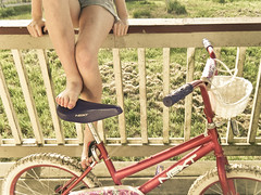 [78/365] (emily golitzin) Tags: charity light summer feet girl bike bicycle fence spring afternoon legs balcony next porch pointandshoot project365 365days 78365 fujifilmfinepixz33wp