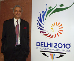 SG posing with Commonwealth Games 2010 logo