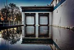A Beachfront Dock (Kyle Kress) Tags: blue sunset urban white reflection brick truck shopping dock pond rust paint decay deep first center diamond forgotten avenue chipped beachfront centered trucking loading evansville flooded intimidating docking deluge abanoned a indinana