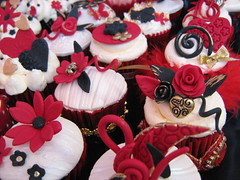 red , black and gold wedding cupcakes (cherries and chives-zaheera badat) Tags: flowers wedding red party white abstract black butterfly fur gold star beads engagement dress heart spirals lace chinese cream curls cupcake gerbera paisley orbs samples pouches oval fondant buttercream quills zaheera badat cherries chives