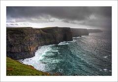 Cliffs of Moher (Felipe Pitta) Tags: county ireland storm galway nature photoshop canon landscape geotagged bay high europa europe clare dynamic natureza doolin paisagem an eire cliffs connemara l burren imaging range 1740mm felipe hdr 1740 moher pitta irlanda mapped tempestade lucisart lucis liscannor tonemapped aillte mhothair felipepitta wwwfelipepittacom felipepittacom geo:lat=52935086 geo:lon=9397087