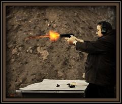 Steady, aim, FIRE! (Sheree (Here intermittently)) Tags: canon photography gun edmonton alberta pistol shooter instructor gunrange gunfire a shereezielke albertaphotographer edmontonphotographer marthasvine targetshooing copyrightshereezielke