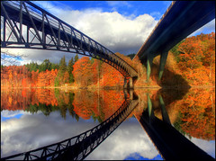 The Bridges - Loch Faskally (angus clyne) Tags: road bridge blue autumn trees red sky orange colour reflection fall clouds foot scotland colours perthshire calm loch a9 flikcr faskally saariysqualitypictures
