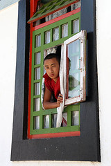 Monk peeping through window-1 (sanmang610) Tags: travel boy red portrait india reflection green tourism window glass colors beauty vertical religious colours buddhist prayer young scenic monk adventure monastery himalaya spiritual sikkim peeping gangtok rumtek travelsofhomerodyssey