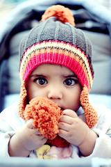 That Innocent Look (*Anfal) Tags: winter boy baby look hat 50mm kid colorful sweet innocent f18 doddi moddi