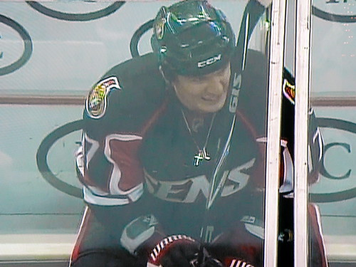 Filip Kubas of the Ottawa Senators sits in the penalty box with his cross.